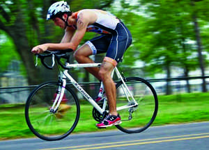 Guy riding a bike.