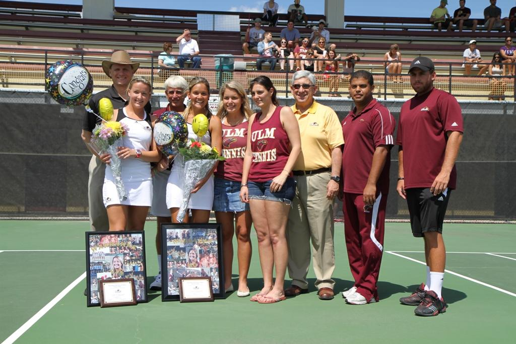 Seniors Vivian Polak (left) and Monica Winkel (right) are presented with flowers, balloons and a picture representation of their careers at ULM during the tennis team's senior day at Heard Stadium.