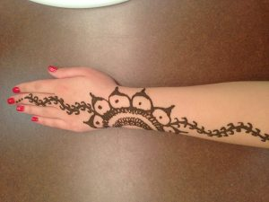 Olivia Barfield shows off Indian design on her hand.