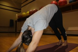 Student, Maddie McCannon, show cases her best yoga moves.
