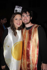Because you can't have eggs without the bacon. Students sporting a breakfast combo for Halloween Ball.