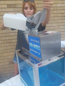 Sarah Wheat pouring ice to make snow cones